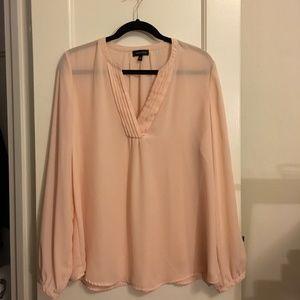 Sheer pink split-neck blouse